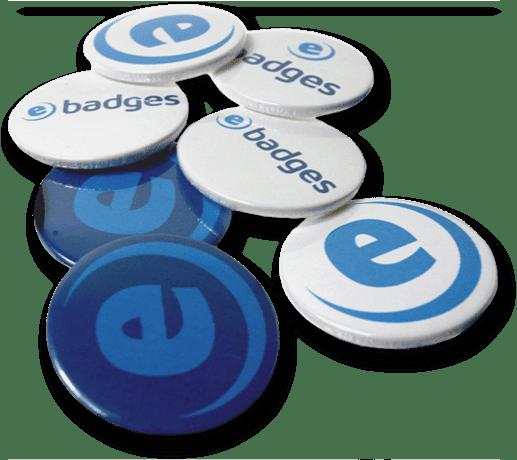 Several made up circular pin badges