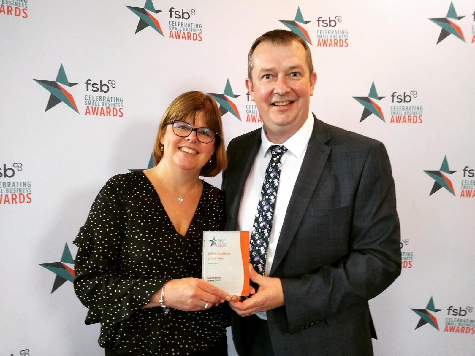 Andrew and Philippa Vear winning Micro Business of the Year regional award from Federation of Small Business FSB